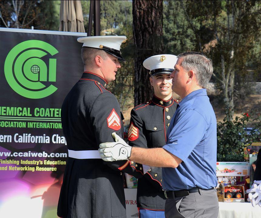 man shaking Marine's hand