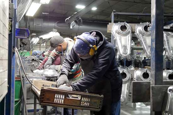 men polishing parts