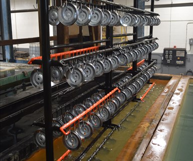 parts racked to be plated