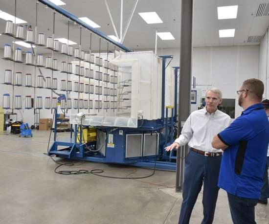 U.S. Senator Rob Portman talk to a man