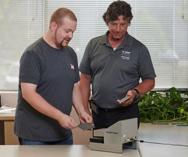 2 men using a testing machine