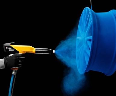powder coating gun spraying a blue coating onto a wheel