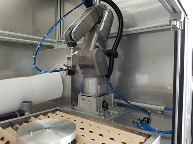 Compact painting cells with robots are a cost-effective way to get started with robot-based painting. Image courtesy of Reiter Oberflächentechnik.