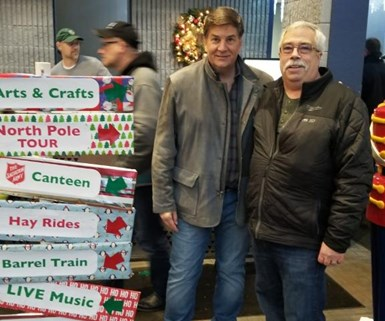 two men standing in front of gifts