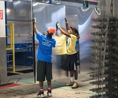people hanging metal sheets
