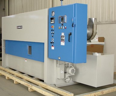 Grieve's No. 1005 cabinet oven is used for curing long composite parts held in fixtures.