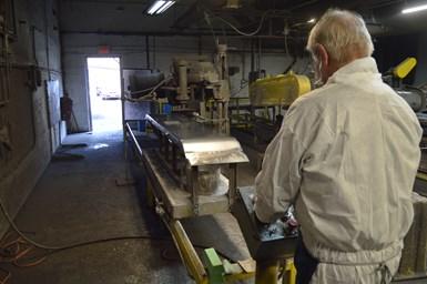 man polishing chrome
