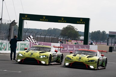 A photo of the winning Aston Martin Vantage and another podium-worthy Aston Martin, both of which used HMG Paint