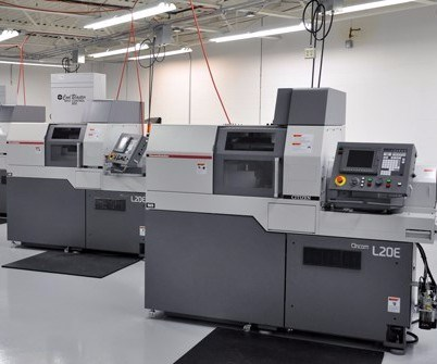 Two Citizen seven-axis CNC Swiss-type machines