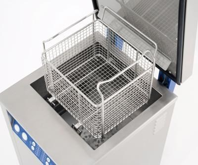 ultrasonic cleaning basket above its tank
