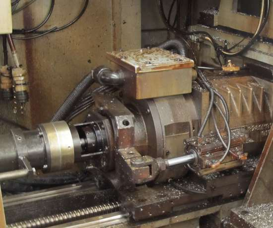 Convertible kit behind the machine's headstock that allows the machine to run with or without a guide bushing