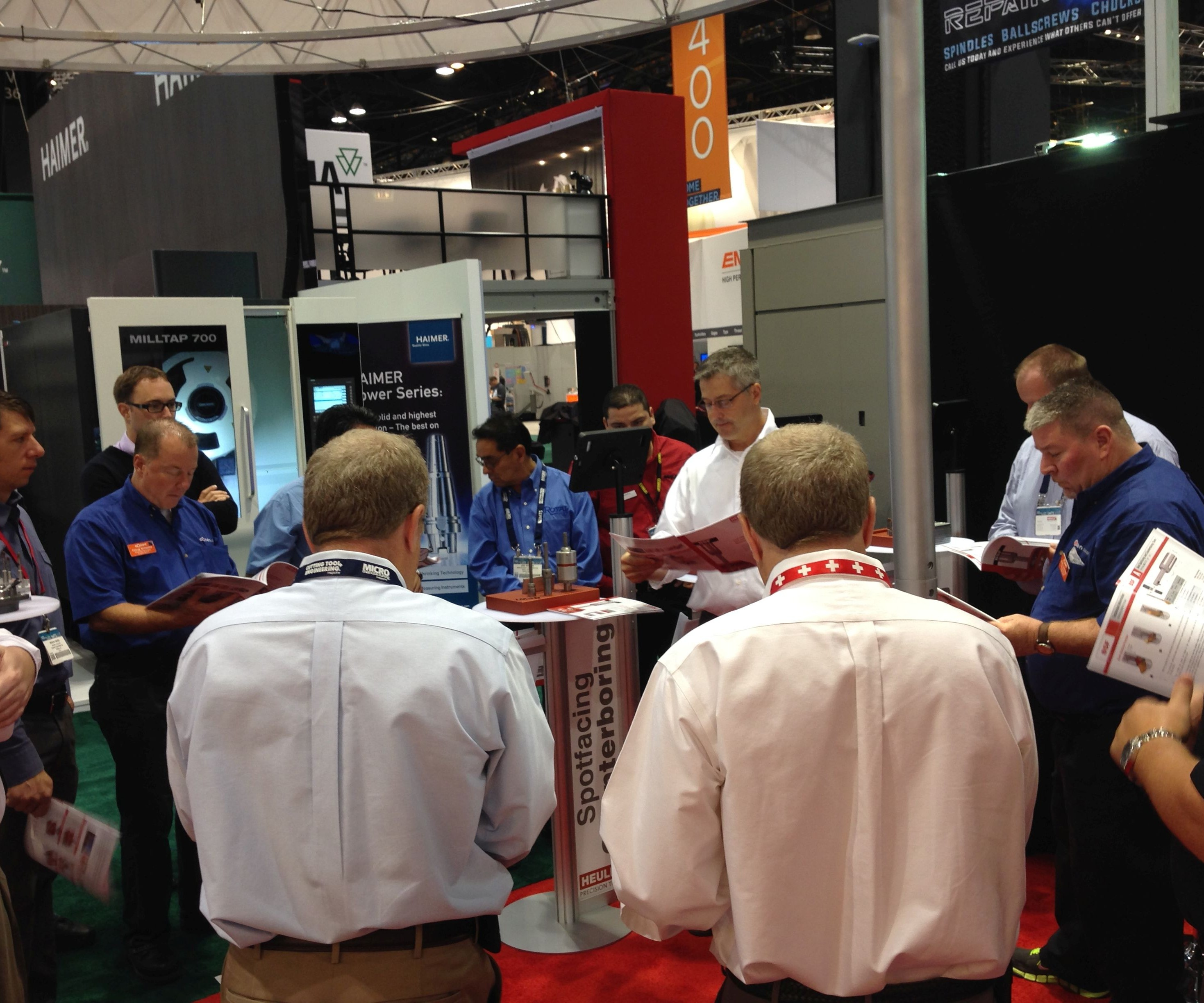 Gary Brown speaking to a group of sales agents at the Heule booth