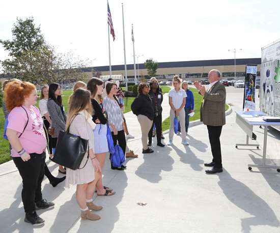 High school students visit the Great Oaks robotics trailer during a Women Leaders in Manufacturing Summit at GE Aviation