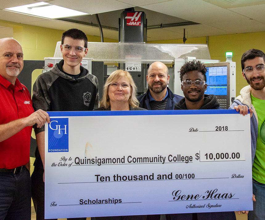 students holding large check representing grant award