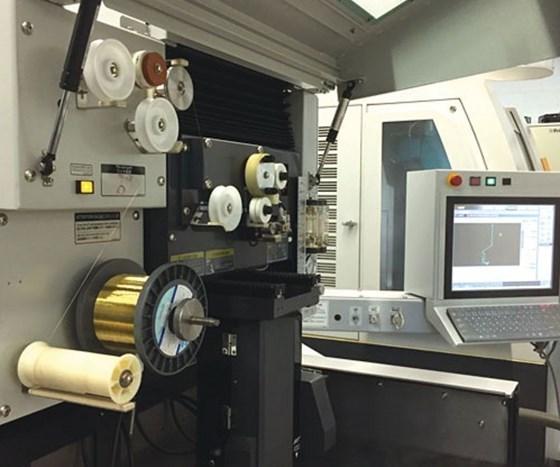 inside the Mitsubishi MD+Pro III EDM machine