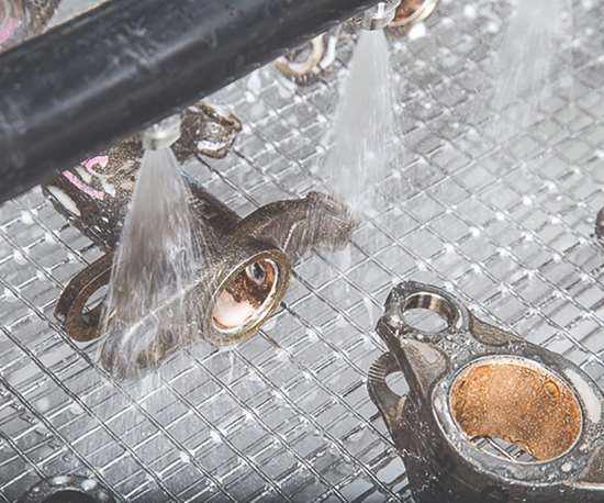 Spray washers use aqueous cleaning compounds