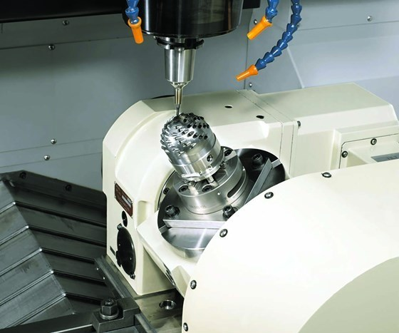 inside of a machine doing five-axis machining
