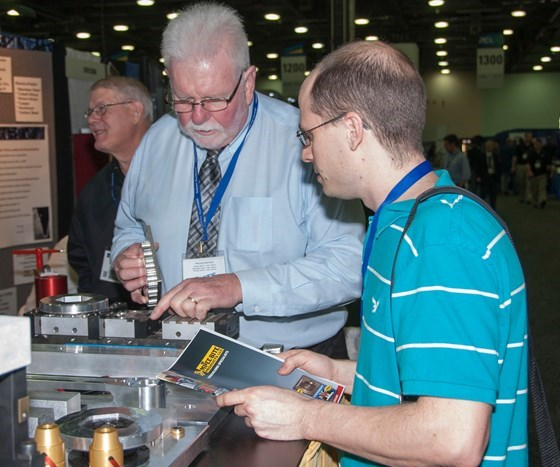 PMTS attendee visiting booth