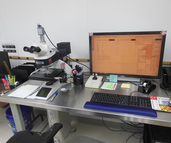Particle-counting microscope