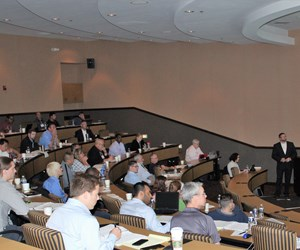 theater full of people and presenter at front
