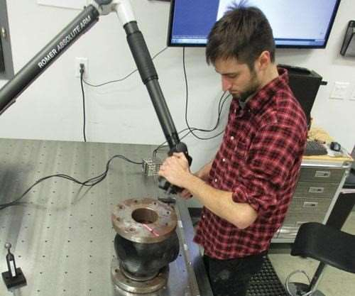 operator working with portable CMM arm