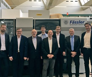 key employees at Gleason and Faessler standing in front of a Faessler machine