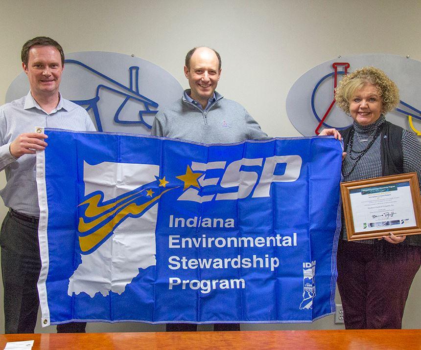 three Madison Chemical employees holding Indiana Environmental Stewardship Program sign