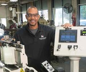 operator standing next to machine