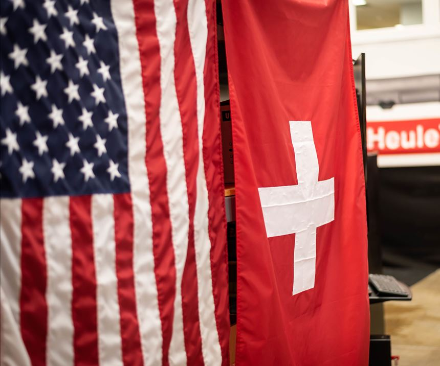 American and Swiss flags