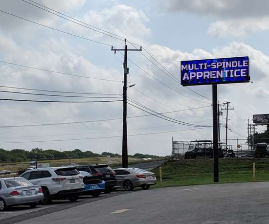 """Multi-Spindle Apprentice"" billboard outside Cox Manufacturing"
