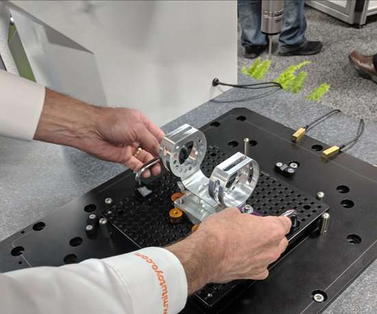 A Mitutoyo employee shows how to quickly switch the fixturing on the MiSTAR 555 CMM