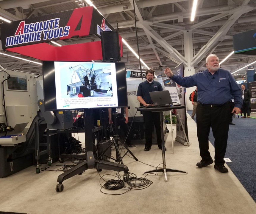 Philip Judt and Greg Knight give a showfloor demo at the Absolute Machine Tools booth