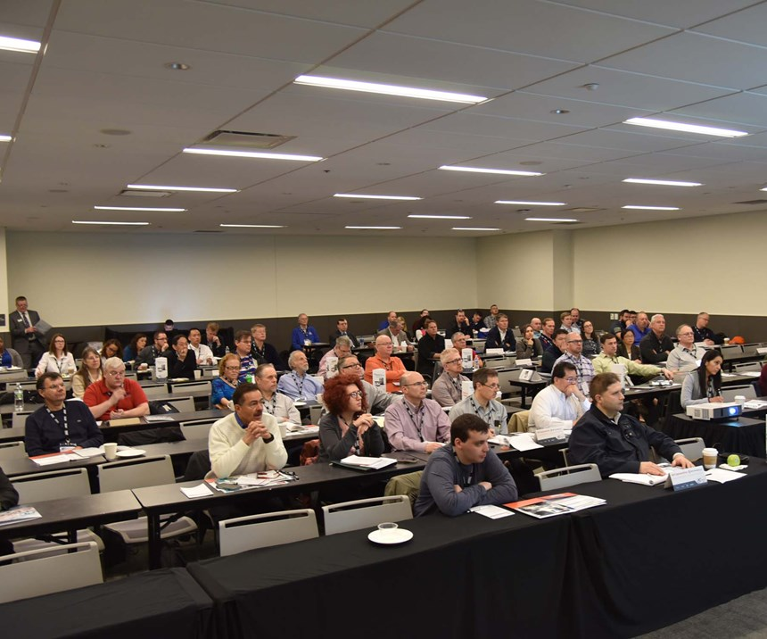 Parts Cleaning Conference attendees watch a presentation