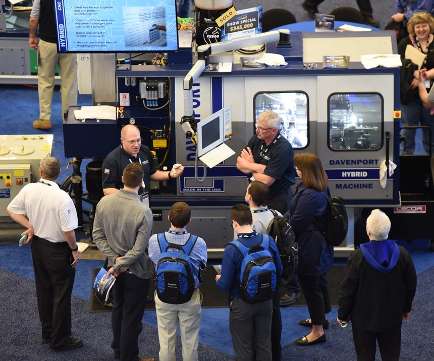 Attendees looking at a hybrid machine in Davenport's booth