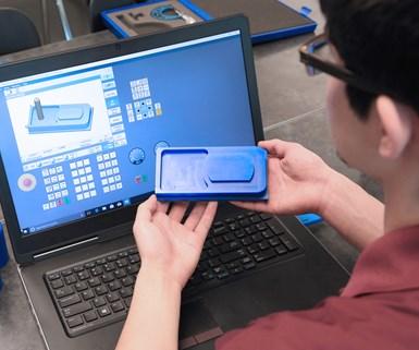 Student using CNC simulator software