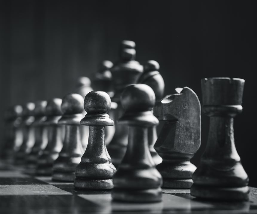 chess game with pieces lined up in order