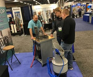 show attendees learning about a cleaning machine in an exhibitor booth