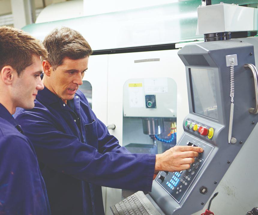 two operators using CNC