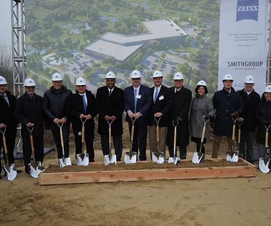 Zeiss staff at groundbreaking event holding shovels and wearing hardhatss