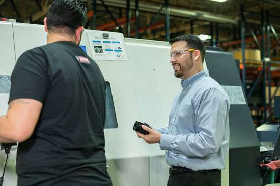 Alejandro Perez and manufacturing manager Justin Henry with the Citizen Miyano ABX-51TH3
