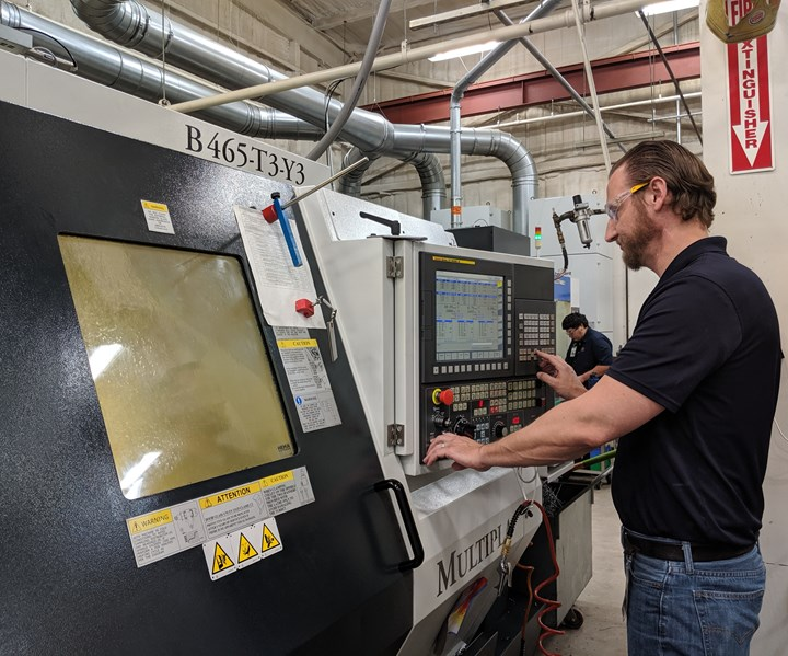 Fixed headstock team leader Ryan Beck using a FANUC control at a lathe