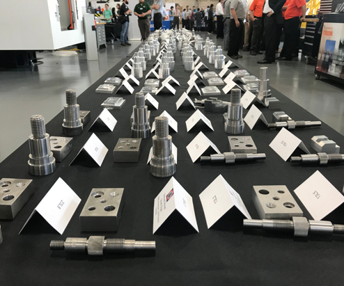 machined parts displayed on a table