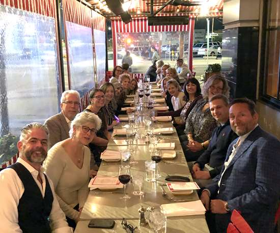 long dinner table filled with PMPA members