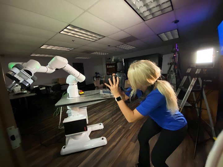 woman taking photo of OB7 robot