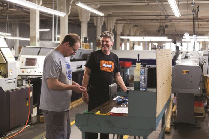 Bagshaw employees enjoying a laugh while working on the shop floor.