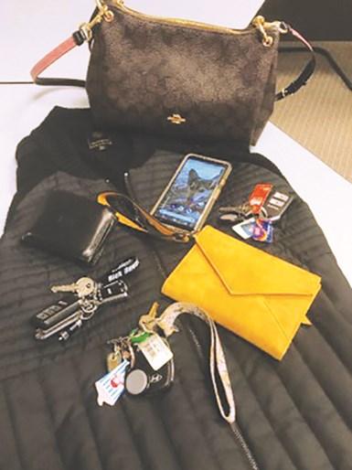 a purse, wallet, phone, keys