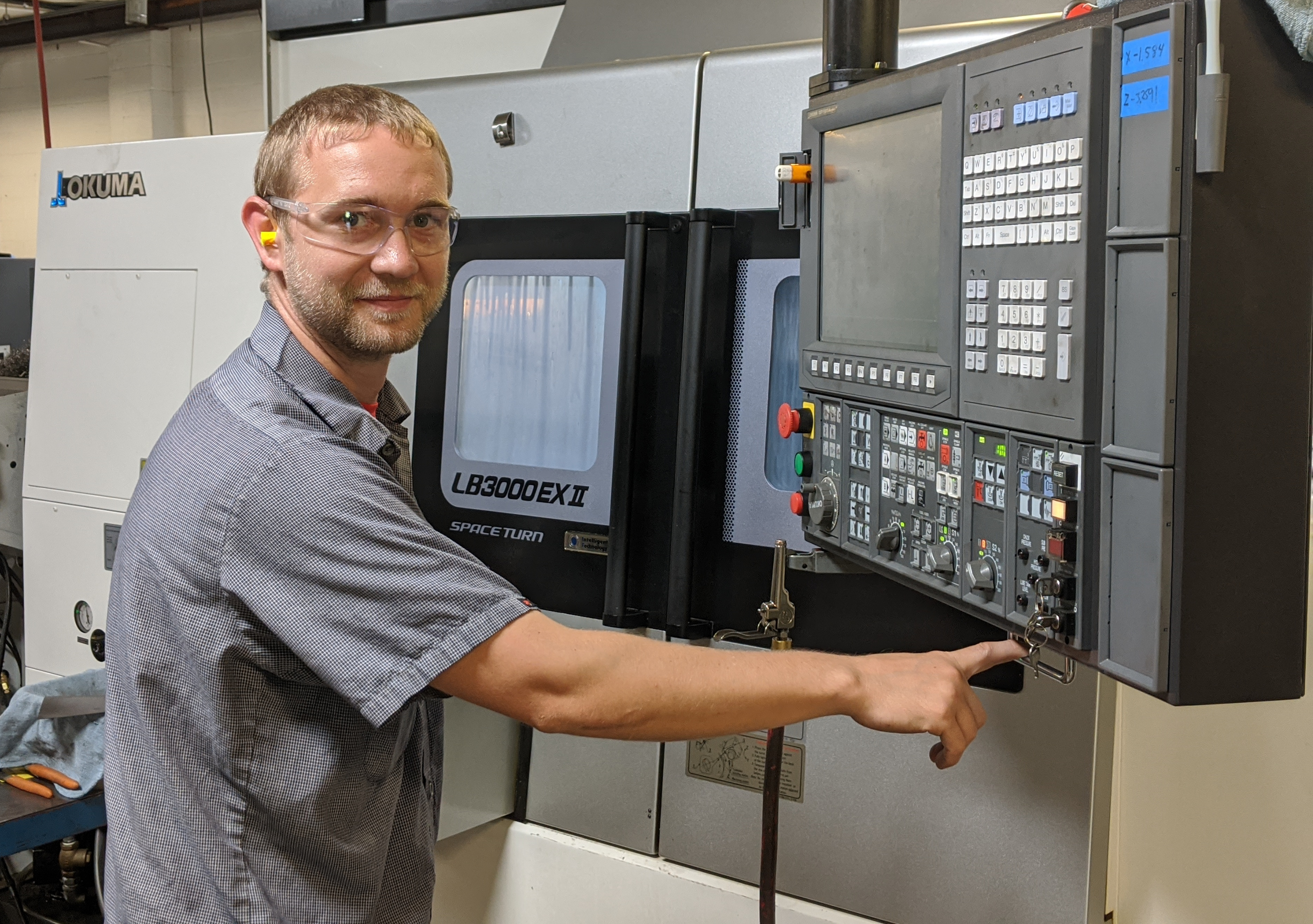Clay Adcock uses machine controller on shop floor