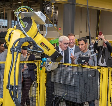 Governor Tony Evers checks out an industrial robot