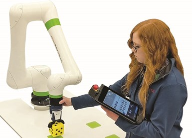 An operator teaches the CRX Collaborative Robot by guiding it manually.
