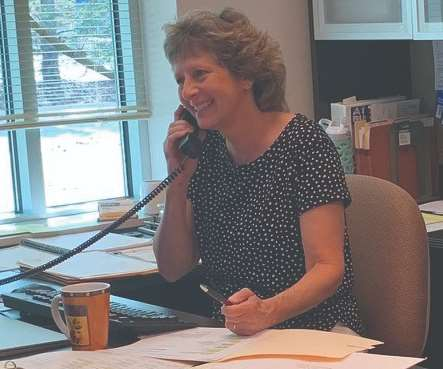 Renee Merker working the phones, planning a valuable and fun Annual Meeting being held at the Big Cedar Lodge in Branson, Missouri, in October.
